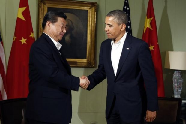 Barack Obama shakes hands with Chinese President Xi Jinping at The Annenberg Retreat