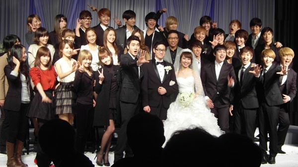 SM Town takes a group photo at a managers wedding