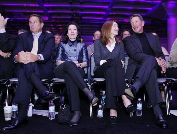 Larry Ellison, right, with his wife, Melanie Ellison, second from right, Oracles co-Presidents Mark Hurd, left, and Safra Catz