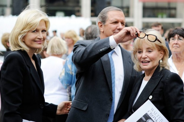 Diane Sawyer, left, smiles as Charles Gibson, center, fiddles with Barbara Walters glasses