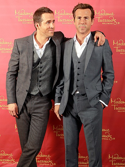 Ryan Reynolds with his wax statue at Madame Tussauds Museum