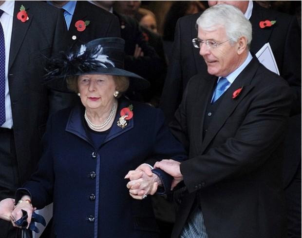 Sir John Major helping Baroness Margaret Thatcher