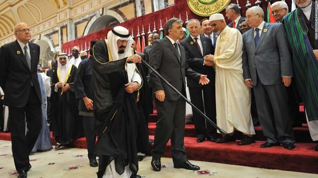 King Abdullah is escorted by Turkish President Abdullah Gul as Lebanese Prime Minister Najib Mikati