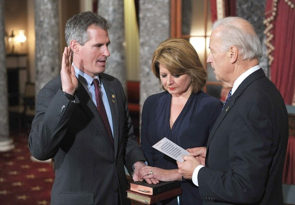 Republican Scott Brown, accompanied by wife Gail Huff, is sworn in to the Senate by Vice President Joe Biden