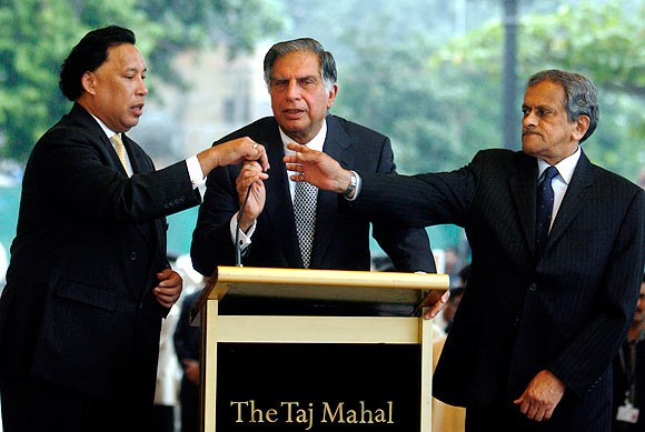 Ratan Tata with Raymond Bickson, left, managing director, Taj Hotels, and R K