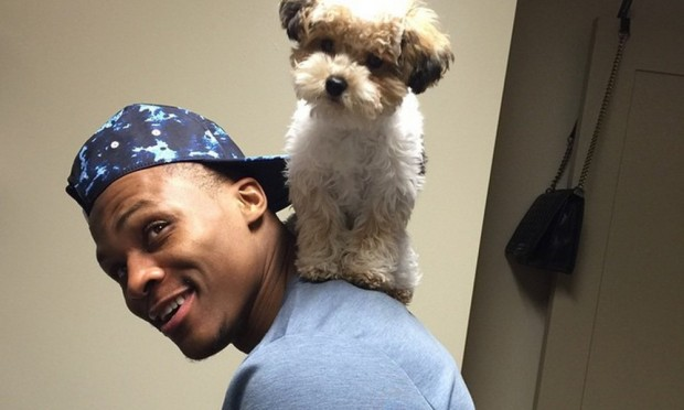 Russell Westbrook with a cute puppy