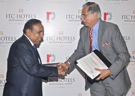 Ravi Pillai Shaking His Hands with ITC Hotels Chairman