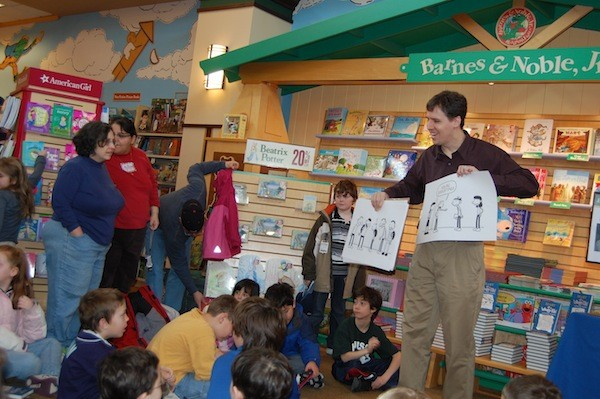 Jeff Kinney Showing His Cartoons to Kids