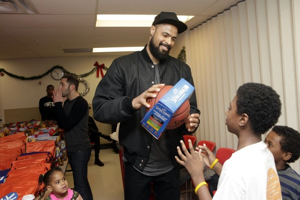 Tyson Chandler Handing Gifts To Young Fans
