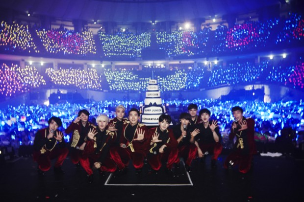 Super Junior pose at their 100th Super Show concert at the Jamsil