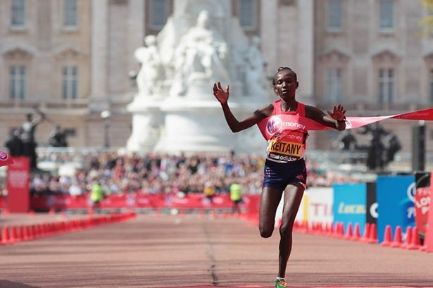 Mary Keitany of Kenya celebrates winning the Womens Elite race during the Virgin London Marathon