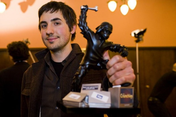 Digg poster boy Kevin Rose shows off his award for Best User-Generated Content Site