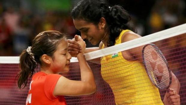 PV Sindhu shaking hands with Nozomi after winning semifinal match