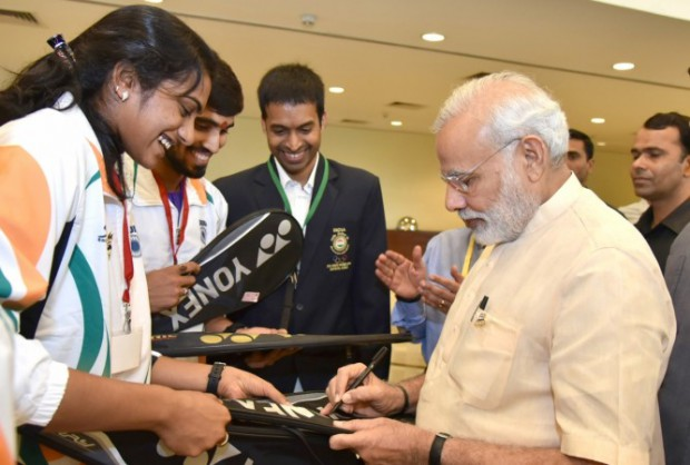 Indian prime minister Narendra Modi signing on Sindhu's Racquet