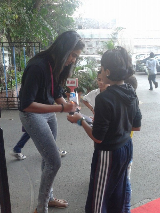 Sindhu signing autographs to her kid fans