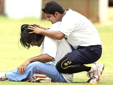 Raina having fun with dhoni's hair