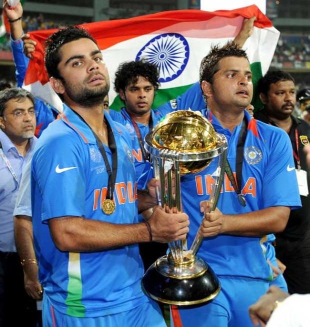 Raina and Kohli with 2011 World Cup Trophy