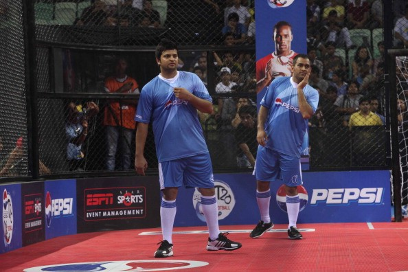 Dhoni and Raina during a football game