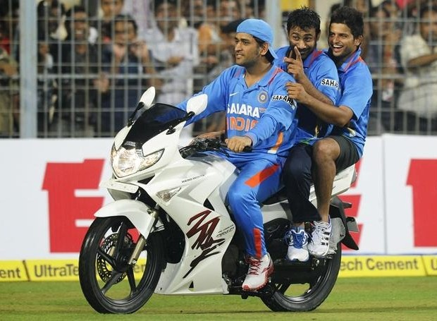 PK and Raina sit behind while MSD riding the bike
