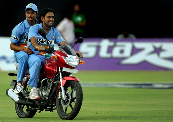 Dhoni and Raina on abike