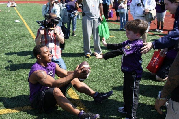 Ray Passing ball to kid