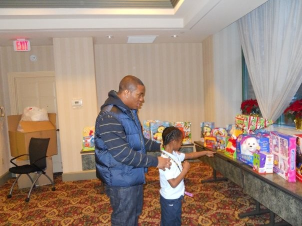 Ray showing presents to a kid