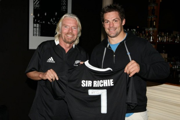 Sir Richard Branson wears an All Black jersey presented by All Black captain Richie McCaw