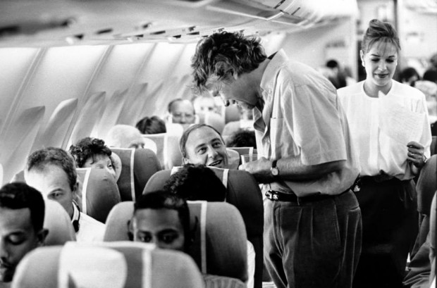 Richard Barson speaking with a passenger in flight