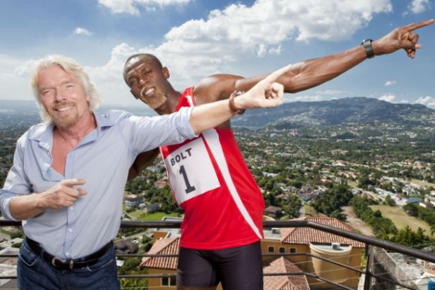 Richard Branson lightening pose with Usain Bolt
