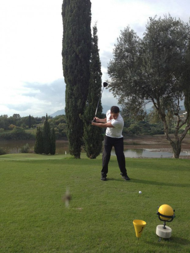 Ryan playing Golf during his Spain visit