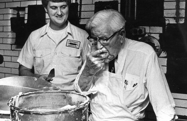 Colonel Sanders tasting iceness for his birthday cake