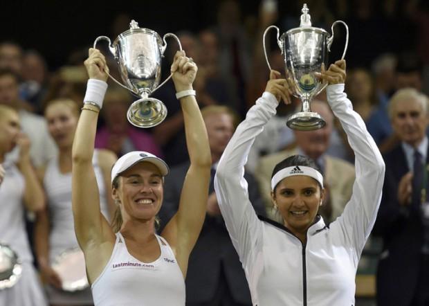 Sania Mirza and Martina Hingis with their Wimbledon trophies