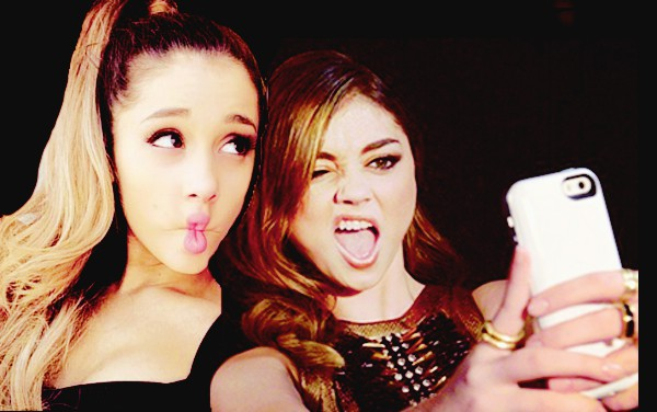 Ariana Grande and Sarah Hyland posing for a selfie