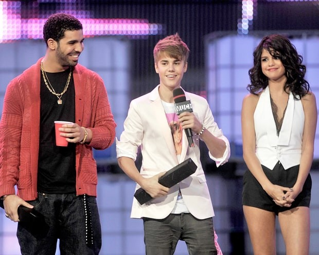 Selena on stage with Justin Bieber and Drake