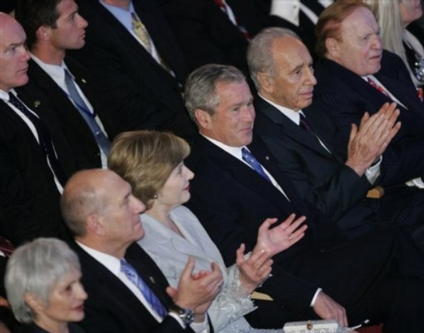 Sheldon Adelson sat in a row along with G. W. Bush