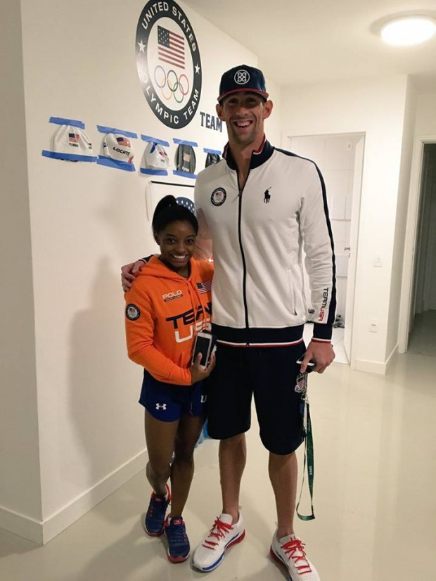 Simone Biles with star swimmer Michael Phelps