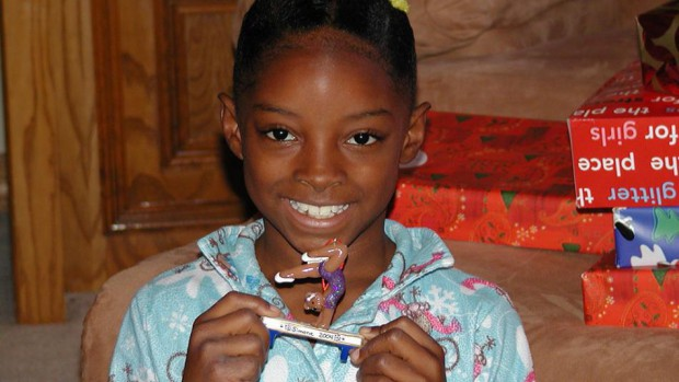 Simone Biles at age of 7 with a prize that she earned