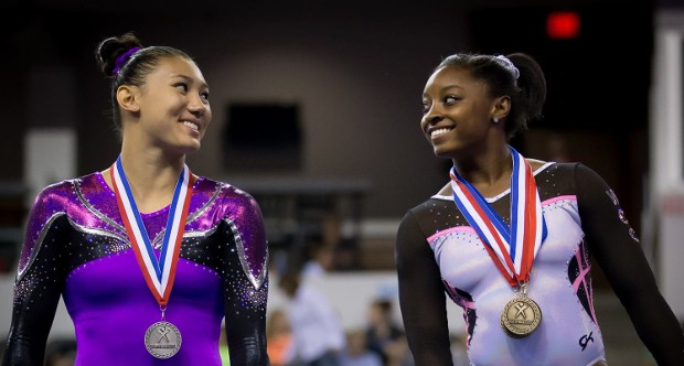 Simone and Kyla ross smiling at podium