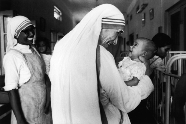 Mother Teresa playing with a little baby
