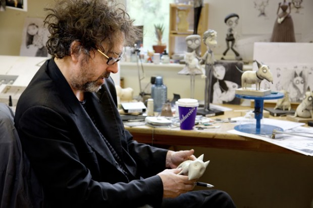 Tim Burton holds a model of Sparky during the making of Frankenweenie