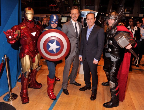 Tom with a reporter and some of the fans as avengers characters
