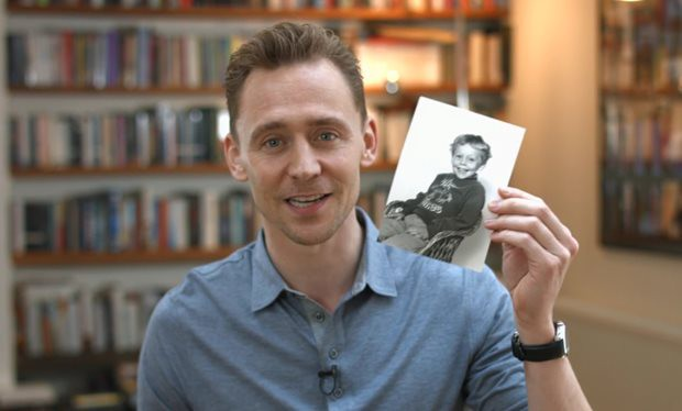 Tom showing his childhood photo during UNICEF campaign