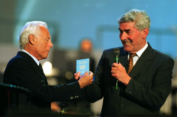Armani Receiving UN Passport From Ruud Lubbers