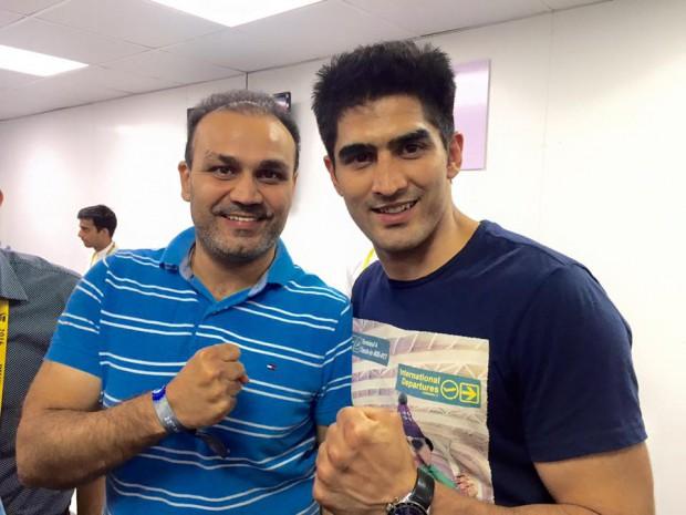 Indian Cricket star Virender Sehwag with Vijender