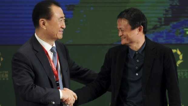 Wang with Alibaba Group co-founder Jack Ma