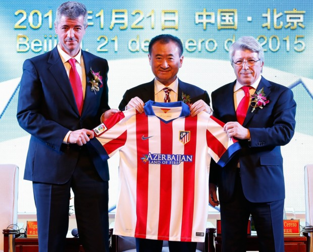 Atletico Madrid CEO Miguel Angel Gil, Wanda Group Chairman Wang Jianlin and Atletico Madrid President Enrique Cerezo