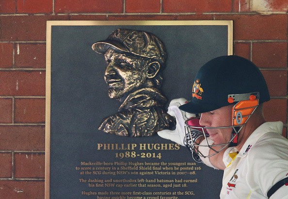 Warner acknowledges Phill Hughes' score