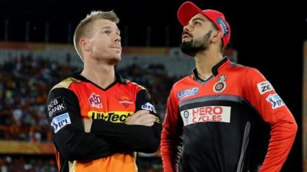 David Warner with Virat Kohli in an IPL match