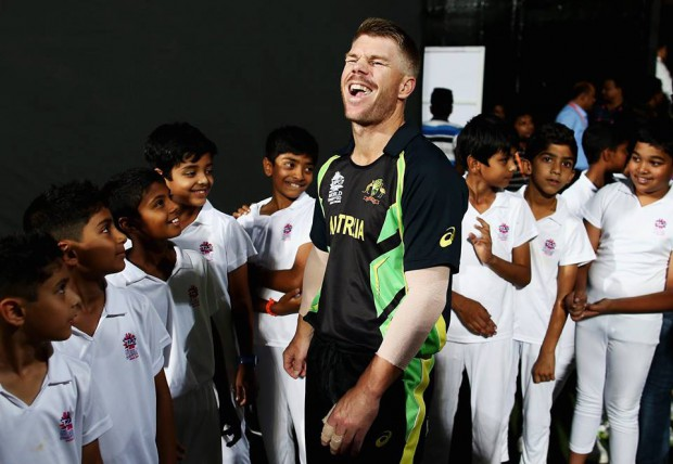 Warner with some school kids