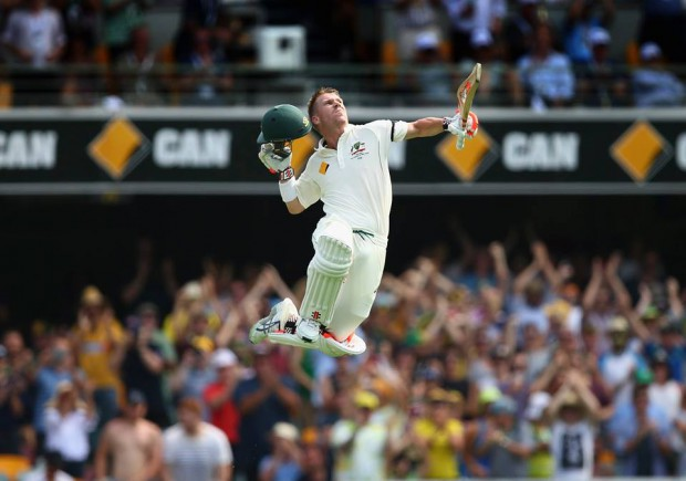 Warner pumps up in the air after scoring his 13th test ton